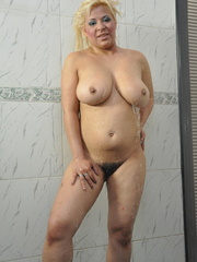 Plump blonde milf pulls down her - Sexy Women in Lingerie - Picture 16