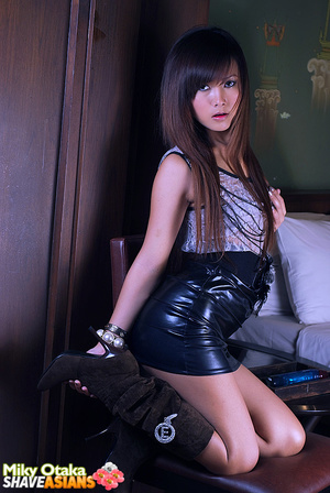 Astonishing brunette asian girl slowly stipping off her latex skirt and playing with blue dildo. - XXXonXXX - Pic 2