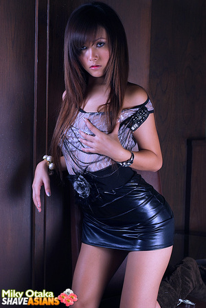 Astonishing brunette asian girl slowly stipping off her latex skirt and playing with blue dildo. - XXXonXXX - Pic 4