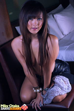 Astonishing brunette asian girl slowly stipping off her latex skirt and playing with blue dildo. - XXXonXXX - Pic 7