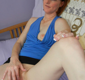 Amazing redhead hosiwife spreading wide on the bed…