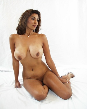 Indian brunette milf sedcutively revealing her shaved pussy of white panties and showing her big melons. - XXXonXXX - Pic 4