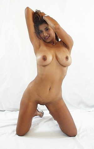 Indian brunette milf sedcutively revealing her shaved pussy of white panties and showing her big melons. - XXXonXXX - Pic 6