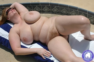 Big breasted redhead sunbathing by the p - XXX Dessert - Picture 5