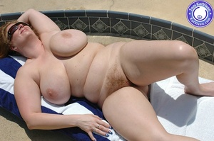 Big breasted redhead sunbathing by the p - XXX Dessert - Picture 6