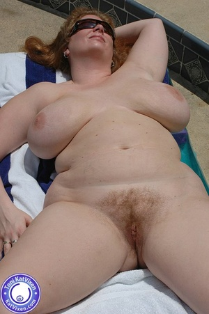 Big breasted redhead sunbathing by the p - XXX Dessert - Picture 7