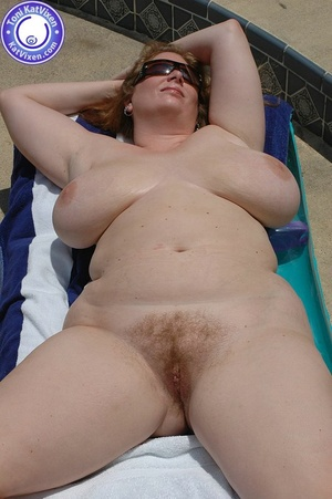 Big breasted redhead sunbathing by the p - XXX Dessert - Picture 8