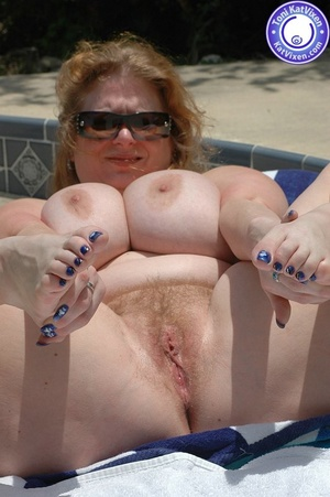 Big breasted redhead sunbathing by the p - XXX Dessert - Picture 11