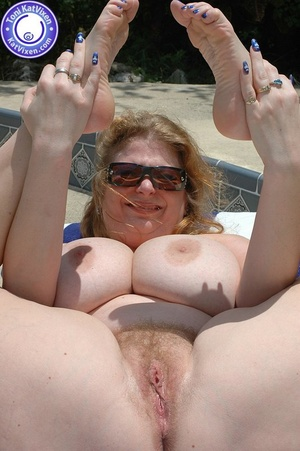 Big breasted redhead sunbathing by the p - XXX Dessert - Picture 13