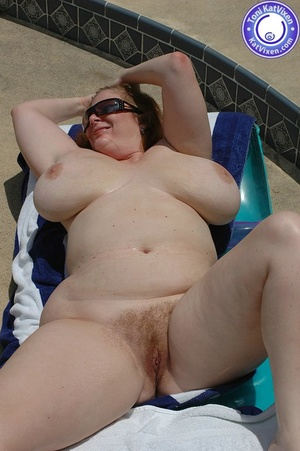 Big breasted redhead sunbathing by the p - XXX Dessert - Picture 15
