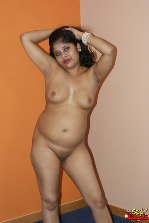 Teen Indian girl takes off her clothes to finger her shaved cooch - XXXonXXX - Pic 10