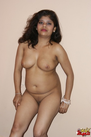 Teen Indian girl takes off her clothes to finger her shaved cooch - XXXonXXX - Pic 11