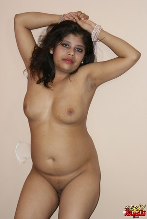Teen Indian girl takes off her clothes to finger her shaved cooch - XXXonXXX - Pic 12