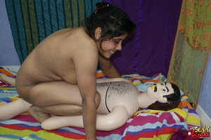 Dirty Indian bitch jumping on her blow-up male doll's cock and then ducks it - XXXonXXX - Pic 1