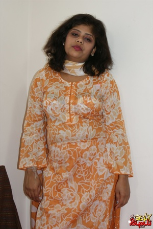 She takes off her orange sari to get naked and demonstrate her chubby Indian forms - XXXonXXX - Pic 1