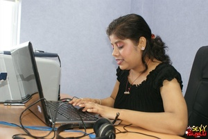 Nasty Indian chick sitting in front of the laptop demonstrating her naked boobs on the Internet - XXXonXXX - Pic 2