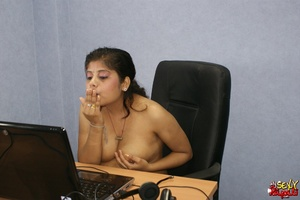 Nasty Indian chick sitting in front of the laptop demonstrating her naked boobs on the Internet - XXXonXXX - Pic 10