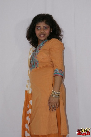 Lewd Indian bitch in orange national costume gets nude to wear her nice lingerie - XXXonXXX - Pic 2
