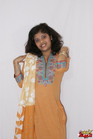 Lewd Indian bitch in orange national costume gets nude to wear her nice lingerie - XXXonXXX - Pic 3