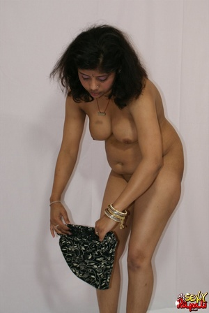 Lewd Indian bitch in orange national costume gets nude to wear her nice lingerie - XXXonXXX - Pic 14