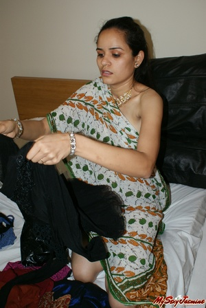 Ponytailed Indian chick Jasmine trying to put on her nice blue sari on her naked body - XXXonXXX - Pic 1