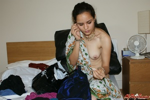 Ponytailed Indian chick Jasmine trying to put on her nice blue sari on her naked body - XXXonXXX - Pic 8