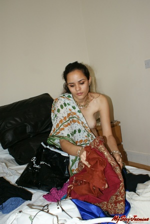 Ponytailed Indian chick Jasmine trying to put on her nice blue sari on her naked body - XXXonXXX - Pic 9