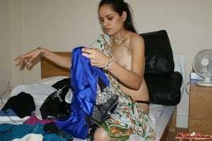 Ponytailed Indian chick Jasmine trying to put on her nice blue sari on her naked body - XXXonXXX - Pic 11