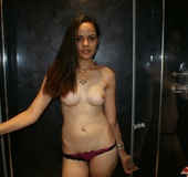 Slim Indian girl Jasmine topless in purple thong…