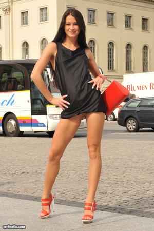 Sexy brunette teen in a black short dres - XXX Dessert - Picture 2