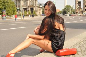 Sexy brunette teen in a black short dres - XXX Dessert - Picture 11