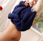 Sexy blonde milf in a blue knitted sweater and…