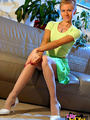 Hot blonde bitch in a green short skirt - Picture 1