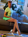 Hot blonde bitch in a green short skirt - Picture 3