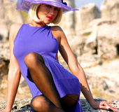 Bodacious blonde lady in a blue dress and a hat…