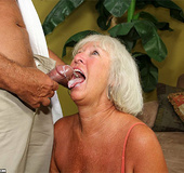 Lustful granny in an orange top gives cool titjob…