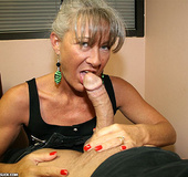 Hot milf in a black top and glasses gets mouthful…