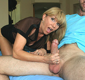 Sexy blonde mom in a black blouse giving a deep…