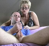 Blonde milf in glasses catches a dude masturbating…