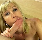 Lustful blonde milf enjoys slobbering man's meat…