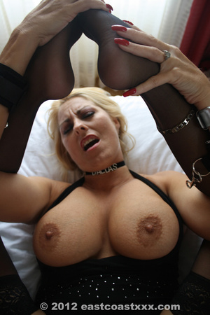 Busty blonde mom in sexy black top, stockings and high boots posing on cam exposing her ripe delights - XXXonXXX - Pic 9