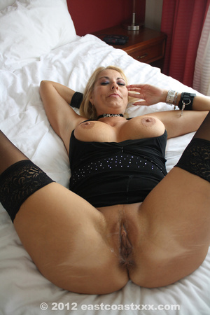 Busty blonde mom in sexy black top, stockings and high boots posing on cam exposing her ripe delights - XXXonXXX - Pic 12
