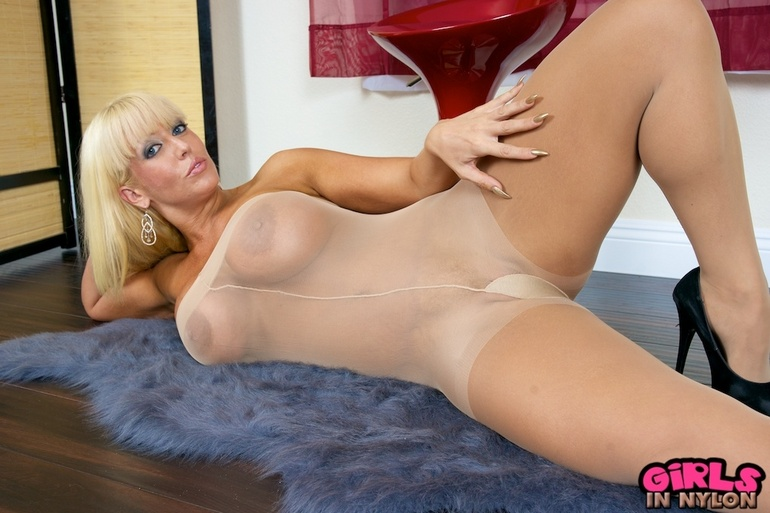 Blonde milf in black nylons hot big tits