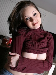 Nice brunette teen girl in a purple turtle-neck and - Picture 6