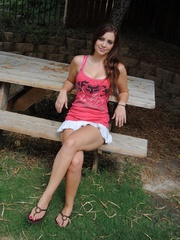 Long-haired teen in a pink vest and a short skirt gets - Picture 1
