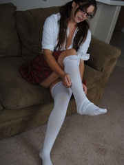 Hot college girl in the uniform and in glasses undresses - Picture 1