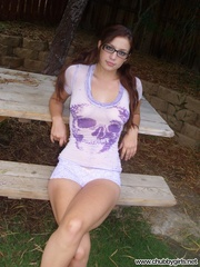Nasty pigtailed chick in glasses lifts up her flowered - Picture 1