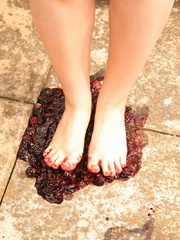 Blonde chubby teen in a lovely dress pressing berries - Picture 7