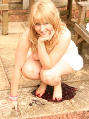 Blonde chubby teen in a lovely dress pressing berries - Picture 9