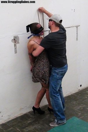 Poor girl gets bound at the wall with a  - XXX Dessert - Picture 2